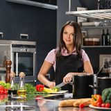 Woman on modern kitchen Stock Photo