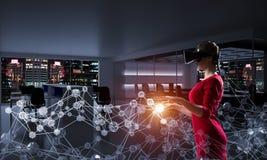 Woman and modern technologies stock photo