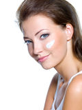Woman with moisturizer cosmetic cream on face Stock Photography