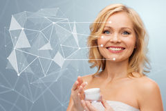 Woman with moisturizer and low poly projection Stock Photography