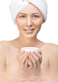 Woman with moisturizing cream Royalty Free Stock Photo