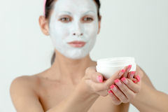 Woman moisturizing face Royalty Free Stock Photos