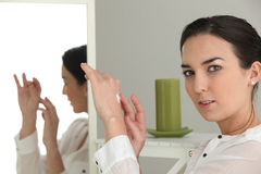 Woman moisturizing her hands Royalty Free Stock Image