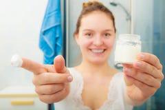 Woman with moisturizing skin cream. Skincare. Royalty Free Stock Image