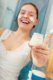 Woman with moisturizing skin cream. Skincare. Royalty Free Stock Photo