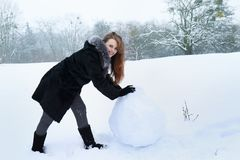 A woman is rolling a ball Stock Images