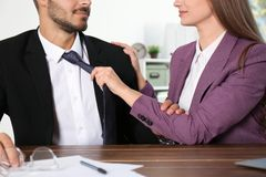 Woman molesting her male colleague in office, closeup. Sexual harassment at work stock photography
