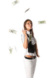 Woman with money. Pretty woman with falling money on a white background Stock Image