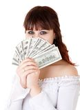 Woman with money. Young brown-haired woman thinking how to spend her money Royalty Free Stock Photos