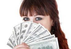 Woman with money. Young brown-haired woman thinking how to spend her money Stock Images