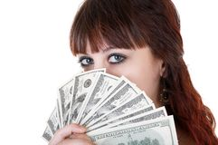 Woman with money. Young brown-haired woman thinking how to spend her money Stock Photos