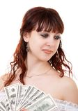 Woman with money. Young brown-haired woman thinking how to spend her money Royalty Free Stock Images