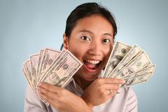 Woman with Money. Businesswoman offering some free cash Royalty Free Stock Photography