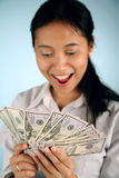 Woman with Money. Happy businesswoman counting her money Royalty Free Stock Photography