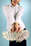 Woman with Money. Businesswoman offering some free cash Royalty Free Stock Photo