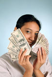 Woman with Money. Businesswoman offering some free cash Royalty Free Stock Image