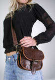 Woman with money belt bag Stock Image