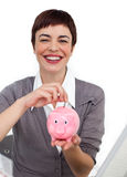 A woman with a money box. And a white background Stock Photos