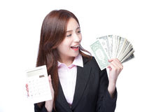 Woman with money and calculator Royalty Free Stock Images