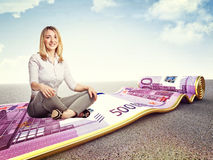 Woman money carpet Stock Image