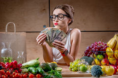Woman with money cash and healthy food Stock Photography