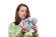 The woman with money Royalty Free Stock Photos