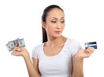 Woman with money and credit card Stock Photography