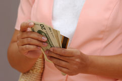 Woman With Money and a Credit Card. Woman in Pink With Money and a Credit Card royalty free stock image