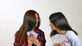 Couple of womans Standing In The Rain From Money. Slow Motion stock footage