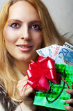 Woman with money (euro) and christmas gift Stock Photo