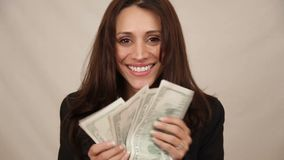 Woman with money. In her hands stock footage