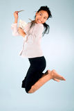 Woman with Money jumping. Young women winning money at the lottery Stock Photography
