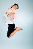Woman with Money jumping. Young women winning money at the lottery Royalty Free Stock Images
