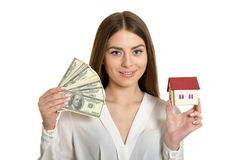 Woman with money and little house Royalty Free Stock Images