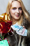 Woman with money and red christmas gift Stock Photos