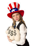 Woman with money sacks isolated on white Stock Photography