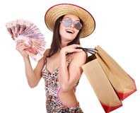 Woman with  money and shopping bag. Stock Photo
