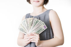 Woman with money in studio Stock Images