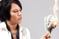 Woman with money to burn Stock Images