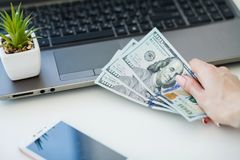Woman With Money at Workplace. Business Concept. Woman With Money at Workplace. Business Concept Stock Images