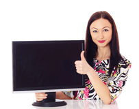 Woman with a monitor. Beautiful woman presenting monitor Royalty Free Stock Photo