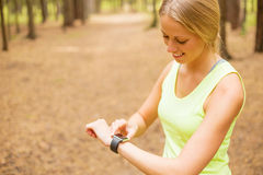 Woman monitoring her pulse on smartwatch Royalty Free Stock Photography