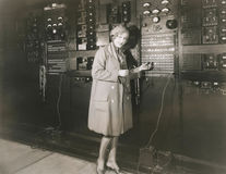Woman monitoring sound in 1930s recording studio Royalty Free Stock Image