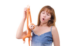 The woman with a monkey sings the song. The young woman with a monkey sings the song Royalty Free Stock Images