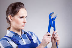 Woman with a monkey wrench Stock Photo