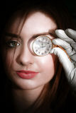 Woman with monocle. Close up on woman face holding monocle to eye Royalty Free Stock Photos