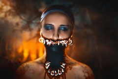 Woman monster. Character with big teeth and black mouth. Professional make up for horror film (faceart, bodyart, aqua grim), cosmetics. Realistic photo. Can be Stock Photo