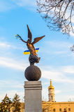 Woman monument with flags. Ukrainian flag at hands of monument Stock Images