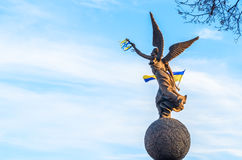 Woman monument with Ukraine flag. Monument in Kharkov with ukrainian flag in sky Royalty Free Stock Image