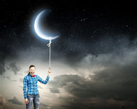 Woman with moon Stock Images